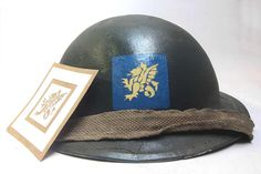 "This is a WW2 British 43rd (Wessex) Infantry Division stencil. It allows you to hand paint the square and dragon on the front of the Tommy Helmet for the ""Fighting Wessex Wyverns"".   www.warhats.com"