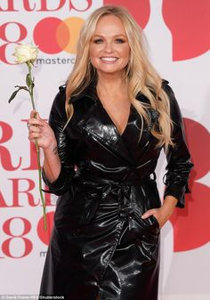 Beaming: Baby Spice added a pop of colour to her appearance with golden-toned eyeshadow and wore her locks in loosely tousled waves Emma Bunton, Baby Spice, Latex Dress, Raincoats For Women, Leather Dresses, Spice Girls, Bold Fashion, Rain Wear, Lady