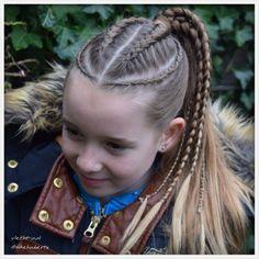 Dutch braids and micro braids into ponytail.