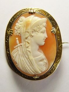Unusual Antique 15K Gold Shell Cameo Brooch Melpomene Goddess (Muse of Tragedy) with a Sword and Mask.