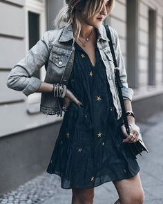 This worn black denim jacket is a great pairing for this Halloween inspired dress.