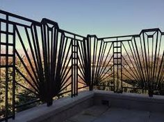 This iron fence uses a repeating pattern to create an Art Deco design. Balustrade Design, Railing Design, Patio Design, Stair Railing, Metal Railings, Stairs, Motif Art Deco, Art Deco Decor, Art Deco Design