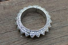 A silver bangle bracelet from Indonesia.  Mystery solved, with thanks.