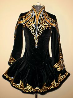 Irish dance solo dress....SO nice to actually see the Celtic designs. Too much BLING takes away from the design.  Dresses have changed SO much since I used to dance  back in the late 1980s!
