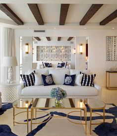 Coastal inspired living room with coffee table in gold and mirrored top [Design: Seed Design]