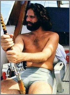 JIm Morrison looks extra hot in his bathing trunks.