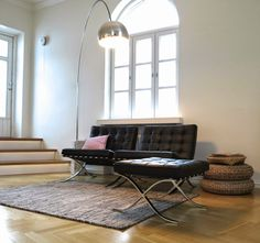 Livingroom with Barcelona chairs from Knoll and Arco lamp.