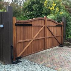 """Elegant double swan neck hardwood driveway gate with fitted underground automation system. Gate from our """"Berkshire"""" collection, waxed iroko timber. Driveway Fence, Driveway Entrance, Driveway Landscaping, Driveway Ideas, Side Gates, Front Gates, Entrance Gates, Wooden Gate Designs, Wooden Gates"""