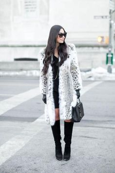 Fur—preferably faux—is a must-have winter coat style and the perfect fabric to shield you from the chill. Whether you favor a long or a cropped style, a fur coat is more wearable than you think. #fur #coat