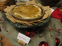 baked brie with muscadine jalapeno jelly and wine cork label