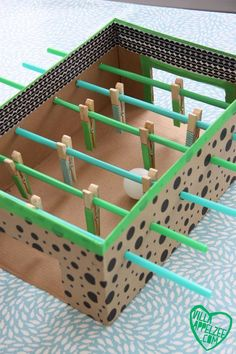 Kids' foosball game. Easy DIY project using a cardboard box.