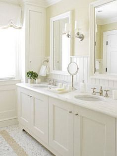 so clean and crisp! Wide beadboard. Love the pale color on the walls and trimmed out mirrors.
