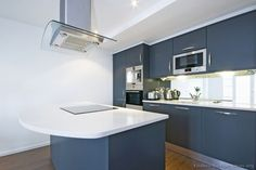 ~ Kitchen of the Day ~ A modern blue kitchen with white countertops, stainless steel appliances, and a mirror backsplash! Kitchen Cabinets Pictures, Blue Kitchen Cabinets, Kitchen Images, Kitchen Wall Decals, Kitchen Decor, Kitchen Tile, Slate Countertop, Stainless Steel Kitchen Appliances, Best Kitchen Designs