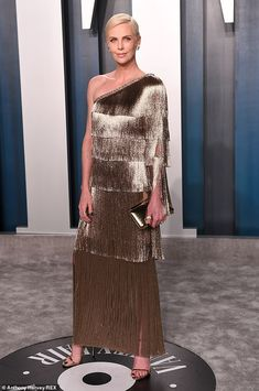 Gold:Charlize Theron lost out on the Best Actress Oscar on Sunday night but wowed in the ...