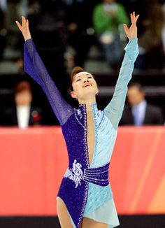 """The midnight-sky blue combo that Shizuka Arakawa of Japan wore at the 2006 Olympic Games in Turin """"isn't my taste,"""" says Wang. Though it was showy, it made Arakawa look like a risk-taker - which might have been the primary intention all along, according to the designer."""