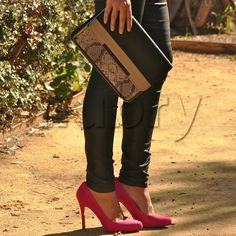 Black leather pants are chic and versatile. Perfect for wearing with a tuxedo blazer.