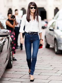 White button-down shirt tucked into skinny jeans and paired with a black belt and black heels