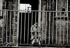 Boy on a rocking horse, East London, 1982; looks like he's in prison