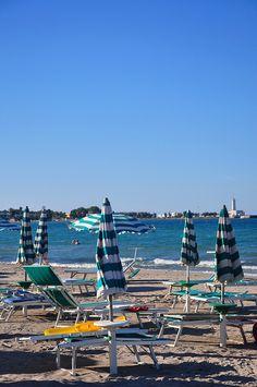 Umbrellas at the beach in Salento Italy