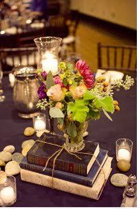 old books stacked for center pieces