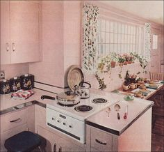 1951 Petal Pink Kitchen - that cooktop!  with the oven in the position where our range is now.  in our kitchen the views from this area would be wonderful.  i cannot stare at a wall while i cook.