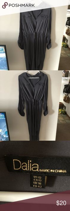 """NWOT High/low button up dress Soft button-up dress with high/low hem. Never worn. Flattering drawstring waist. Can be worn long sleeve or rolled up to 3/4"""". Color is dark grey. Length falls right below knee. Dalia Dresses High Low"""