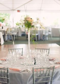 Tall centerpieces.... Gorgeous! Peach and grey wedding