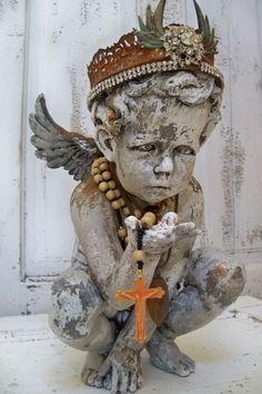 French Santos cherub with handmade crown.