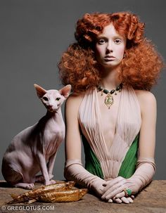 strange portrait of hairless cat and little red-haired girl and two gold fish, like really gold