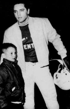 Elvis playing football with his local team in Memphis in july 20 1962. Here wearing his baby blue Girls Girls Girls jacket and later used in the movie Roustabout.