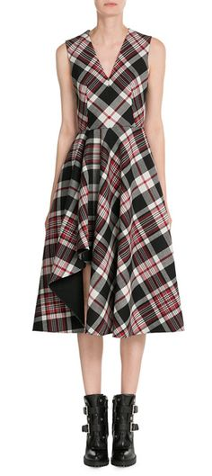 Alexander McQueen's tartan printed dress is made from structured virgin wool and styled with a ruffled accent at the front. The V-neckline keeps it sharp and directional, with a modest midi length that can be dressed for day or night #Stylebop