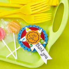 Create a Quick Party Favor: Layer scrapbooking supplies on top of a lollipop wrapper. Add a special thank-you message to personalize.
