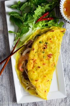 Vietnamese Crepe (Banh Xeo) is thin, crispy and filled with shrimp, pork, and crunchy vegetables.