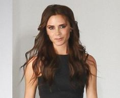 Victoria Beckham smiled.