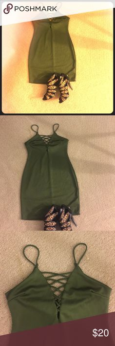 Olive Green BodyCon Dress. NEVER WORN! Form fitting olive green bodycon dress with front crisscross detail. NEVER WORN! (Tags have been removed). Dresses