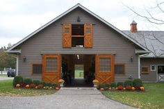 Grace Farm with its stable. This farm is the former home of Reed Kessler and her family. Reed was the youngest rider to represent the US on the Olympic Show Jumping Team in London and trained 6 months of the year at this estate of rolling meadows. Dream Stables, Dream Barn, Horse Stables, Horse Farms, Grace Farms, Small Barns, Barn Living, Barn Plans, Rind