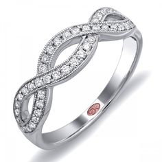 DemarcoJewelry.com  Available in White or Yellow Gold 18KT and Platinum. 0.26 RDCapture her grace and endless beauty with this confident yet elegant design. We have also incorporated a unique pink diamond with every single one of our rings, symbolizing that hidden, unspoken emotion and feeling one carries in their heart about their significant other. This is not just another ring, this is a heirloom piece of jewelry.   Demarco Bridal Engagement Ring.
