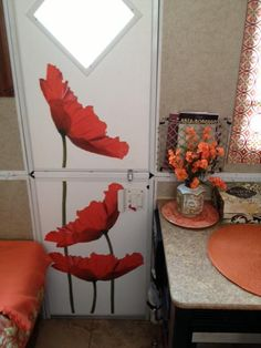 Decals on camper door - Stick tile carpet - Wallpaper are easy fix ideas