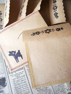 sewn paper envelopes. Maybe use large paper bags to make a card and envelope.