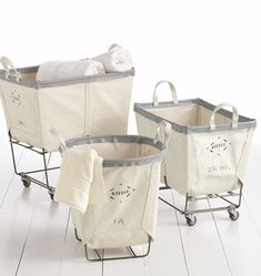 Steele rolling laundry carts. Could use these instead of building laundry bin drawers...?