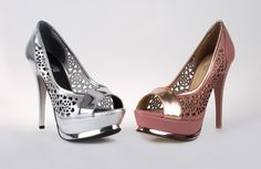 slippers in pink and silver  heart shaped perforations  High Heel fifteen centimatros  Color is golden platform has a variety of cuts your plataformo patent leather is very comfortable and are in different colors is a shoe  broadly designed for smart girls