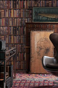 I like the look, but I'd rather have real books! Now though, couldn't you use old books spines as wallpaper though? Hmmm....