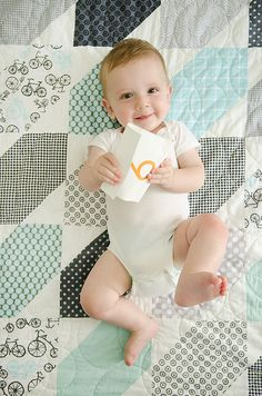 Camille Roskelley's very cute baby on a quilt with fabrics I love.  Have to identify that wheel fabric! by croskelley, via Flickr