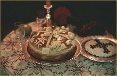 Kolach and Koljivo on the table with the Slava candle - Sretna Slava