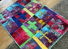 The Holy Cross Quilt - 4th Grade CCD at St. Thomas Church #religion #cross #blanketstitch #applique #quilt #kidsquilt