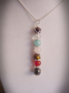 7 Chakra Wand Pendant Semi Precious Stones by CherylsHealingGems, $31.00. Free US Shipping.