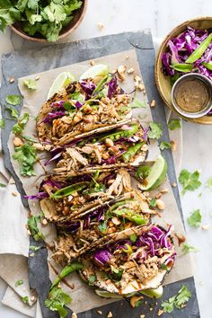 Super tasty and easy to make, these Asian style pork tacos with a red cabbage slaw will satisfy any appetite. The meat is already pre-seasoned for ease too.