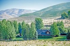 18 rolling acres with seasonal stream and pond backing to BLM lands just down the road from world famous Sun Valley Idaho. This is a true Idaho horse ranchette. No detail or expense was spared in creating the equestrian set-up. Magnificent ~4,400 square foot log home featuring five bedrooms, country kitchen, soaring river rock fireplace and expansive outdoor entertaining patios. Attached garage and ultimate workshop PLUS detached four stall barn with hay storage and tack room. 210' x 70' ...