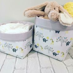 A gorgeous pair of baskets in this pretty elephant and giraffe fabric.  They coordinate well with our Elephants