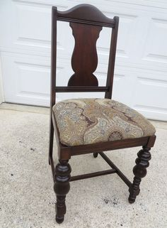 This chair was first fully restored. To match the original colors, it was first stained with General Finishes Dark Mahogany Stain which was almost completely removed, then the chair was completed with Java Gel Stain. Once it was completely dry, a semi gloss high performance top coat was used. Multiple coats were applied and were hand sanded with 400 grit sandpaper between coats. The finial finish is spectacular.